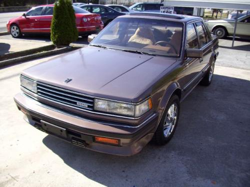 Photo Image Gallery & Touchup Paint: Nissan Maxima in Medium Pewter Metallic  (215)  YEARS: 1985-1986