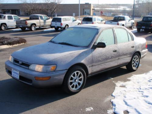 Photo Image Gallery & Touchup Paint: Toyota Corolla in Silver Taupe Metallic  (923)  YEARS: 1995-1995