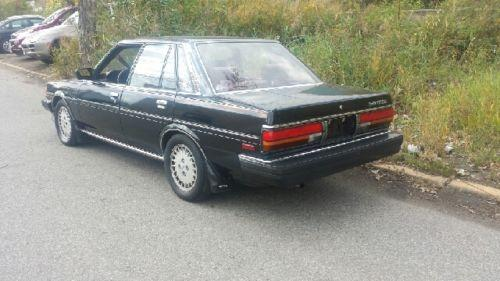 Photo Image Gallery & Touchup Paint: Toyota Cressida in Black    (202)  YEARS: 1988-1988